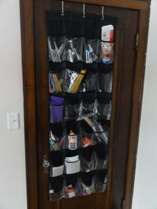 I keep most of our basic school supplies organized in this over-the-door shoe organizer.